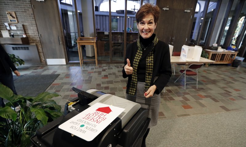 Iowa Gov. Kim Reynolds reacts after casting her ballot in the general election, Tuesday, Nov. 6, 2018, at the United Methodist Church in Osceola, Iowa. (AP Photo/Charlie Neibergall)