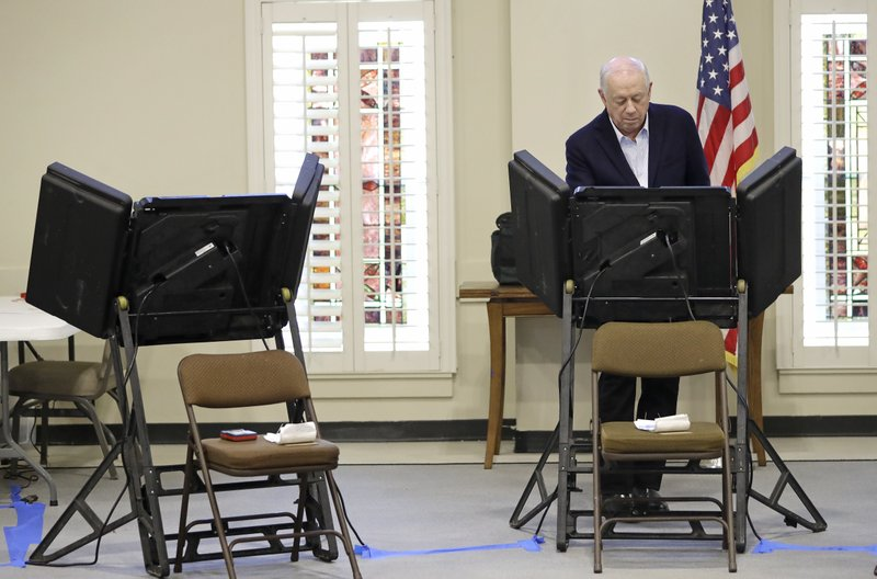 Former Gov. Phil Bredesen votes Tuesday, Nov. 6, 2018, in Nashville, Tenn. Bredesen is running against Rep. Marsha Blackburn, R-Tenn., for the U.S. Senate. (AP Photo/Mark Humphrey)