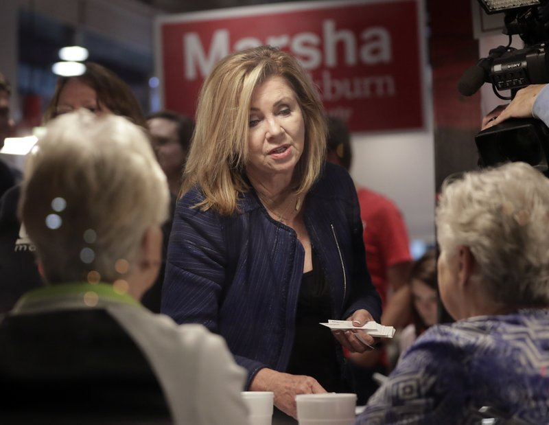 U.S. Rep. Marsha Blackburn, R-Tenn., campaigns at a restaurant, Monday, Nov. 5, 2018, in Smyrna, Tenn. Blackburn is running against former Gov. Phil Bredesen for the U.S. Senate. (AP Photo/Mark Humphrey)