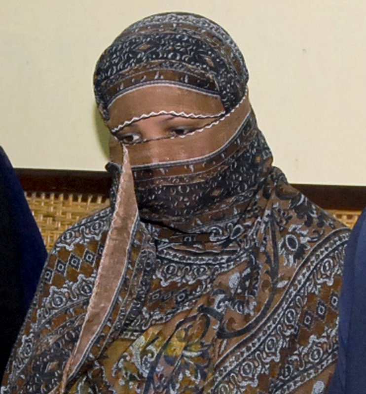 FILE - In this Nov. 20, 2010, file photo, Asia Bibi, a Pakistani Christian woman, listens to officials at a prison in Sheikhupura near Lahore, Pakistan. Italy is working to help relocate the family of a Pakistani Christian woman acquitted eight years after being sentenced to death for blasphemy, amid warnings from her husband that their life is in danger in Pakistan.  (AP Photo, File)
