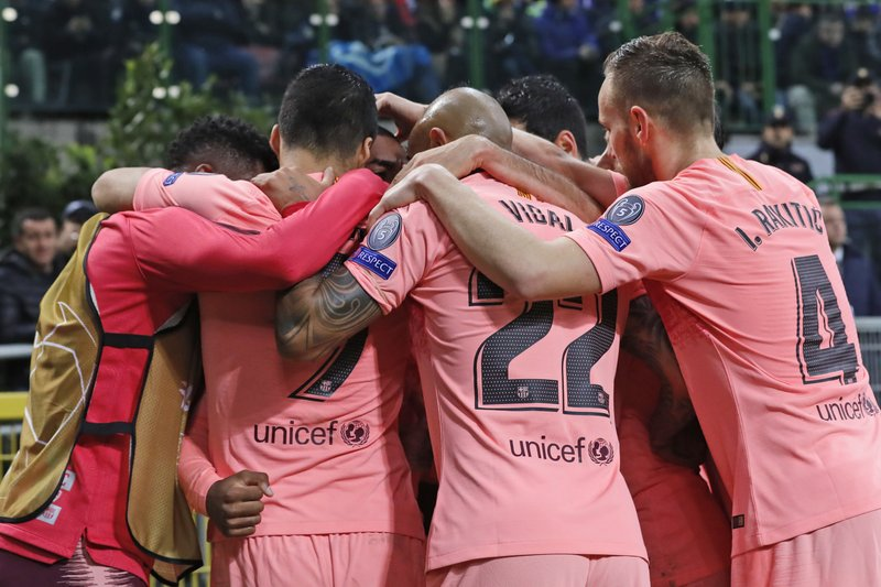 Barcelona players celebrate scoring their side's first goal during the Champions League group B soccer match between Inter Milan and Barcelona at the San Siro stadium in Milan, Italy, Tuesday, Nov. 6, 2018. (AP Photo/Antonio Calanni)