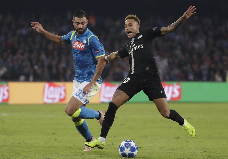 PSG's Neymar, right, and Napoli's Raul Albiol vie for the ball during a Champions League, group C soccer match between Napoli and Paris Saint Germain, at the San Paolo stadium in Naples, Italy, Tuesday, Nov. 6, 2018. (AP Photo/Andrew Medichini)