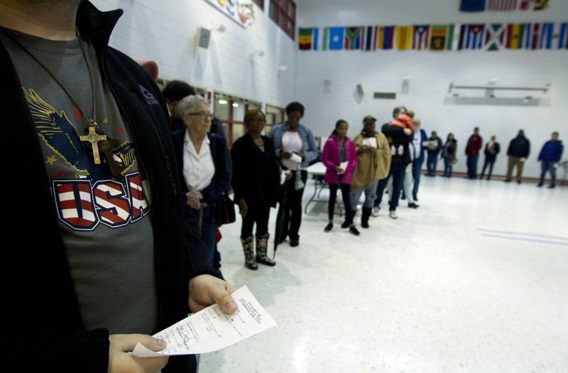 People wait in line at polling place during election day, Tuesday, Nov. 6, 2018, in Silver Spring, Md. (AP Photo/Jose Luis Magana)