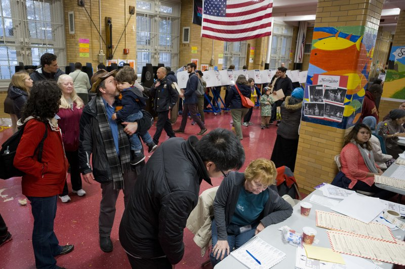 Voters line up at a polling station, Tuesday, Nov. 6, 2018, in the Brooklyn borough of New York. (AP Photo/Mark Lennihan)