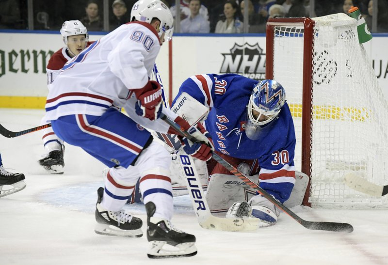 New York Rangers goaltender Henrik Lundqvist (30) covers up the puck as Montreal Canadiens left wing Tomas Tatar (90) skates in during the first period of an NHL hockey game Tuesday, Nov. 6, 2018, at Madison Square Garden in New York. (AP Photo/Bill Kostroun)