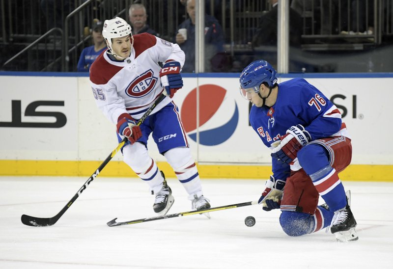 New York Rangers defenseman Brady Skjei (76) blocks a shot by Montreal Canadiens right wing Andrew Shaw (65) during the first period of an NHL hockey game Tuesday, Nov. 6, 2018, at Madison Square Garden in New York. (AP Photo/Bill Kostroun)