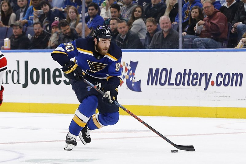 St. Louis Blues' Ryan O'Reilly skates with the puck during the second period of an NHL hockey game against the Carolina Hurricanes Tuesday, Nov. 6, 2018, in St. Louis. (AP Photo/Billy Hurst)