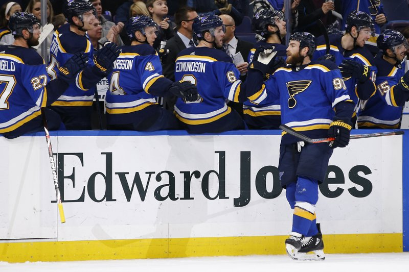 St. Louis Blues' Ryan O'Reilly is congratulated by teammates after scoring a goal against the Carolina Hurricanes during the first period of an NHL hockey game Tuesday, Nov. 6, 2018, in St. Louis. (AP Photo/Billy Hurst)