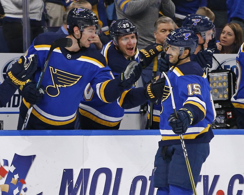 St. Louis Blues' Robby Fabbri, right, is congratulated by teammates Alexander Steen and Zach Sanford, left, after scoring a goal against the Carolina Hurricanes during the first period of an NHL hockey game Tuesday, Nov. 6, 2018, in St. Louis. (AP Photo/Billy Hurst)