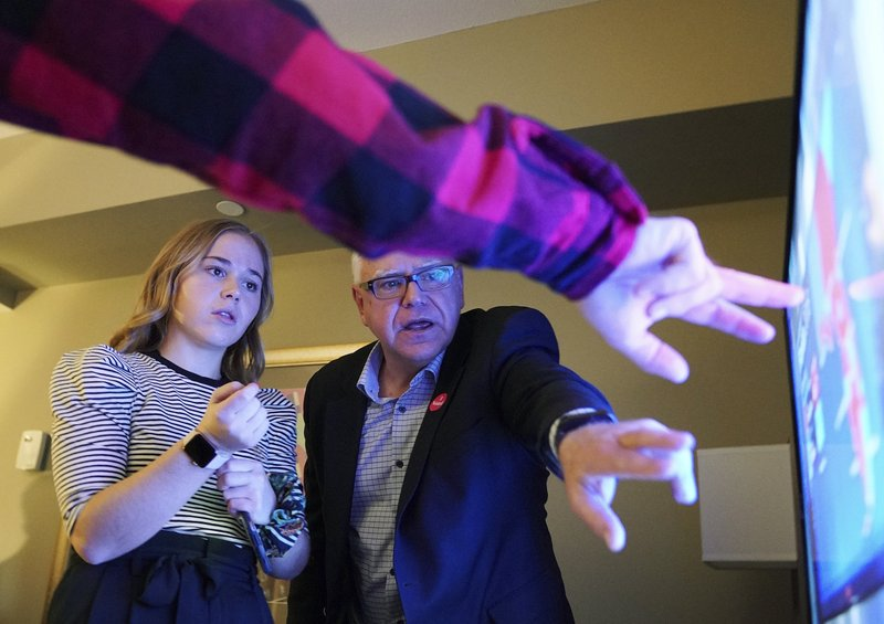 Tim Walz, a Democratic-Farmer-Labor gubernatorial candidate, watches election results with his extended family in their hotel suite at the Intercontinental Hotel in downtown St. Paul, Minn., Tuesday, Nov. 6, 2018. DFL candidates, officials and supporters gathered for the election watch party at the hotel. (Anthony Souffle/Star Tribune via AP)