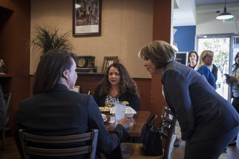 New Mexico Democratic gubernatorial candidate Michelle Lujan-Grisham speaks to constituents at Cocina Azul restaurant in Albuquerque, N.M., on midterms election day Tuesday, Nov. 6, 2018. (AP Photo/Juan Labreche)