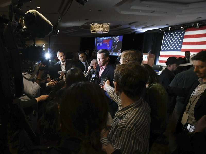 Gov. John Hickenlooper is swarmed by the media at the watch party for Colorado Democrats at the Westin Hotel in downtown Denver before the polls close Tuesday, Nov. 6, 2018. (Jerilee Bennett/The Gazette via AP)
