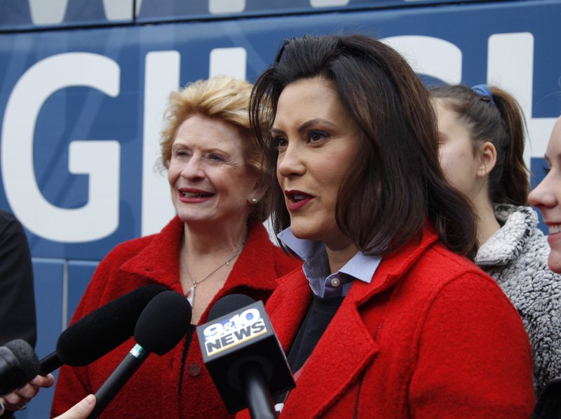 Michigan Democratic gubernatorial candidate Gretchen Whitmer, right, answers questions with Sen. Debbie Stabenow, D-Mich., after casting her ballot Tuesday, Nov. 6, 2018, at St. Paul Lutheran Church in East Lansing, Mich. (AP Photo/Al Goldis)