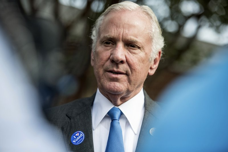 South Carolina Governor Henry McMaster talks with the press after casting votes at a polling station Tuesday, Nov. 6, 2018, in Columbia, S.C. Voters in thirty six states will cast ballots in gubernatorial races on Tuesday. (AP Photo/Sean Rayford)