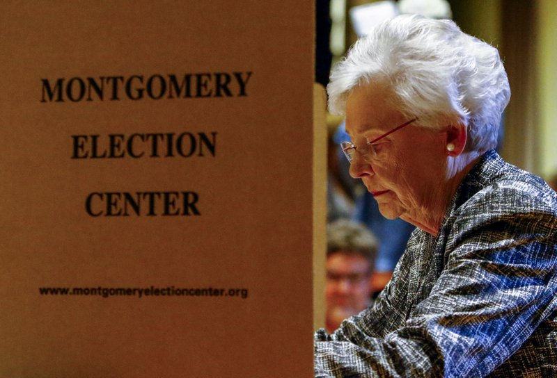Alabama Governor Kay Ivey cast her vote at Huntingdon College Tuesday, Nov. 6, 2018, in Montgomery, Ala. (AP Photo/Butch Dill)