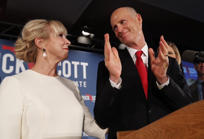 Republican Senate candidate Rick Scott thanks his wife Ann as he speaks to supporters at an election watch party, Wednesday, Nov. 7, 2018, in Naples, Fla. (AP Photo/Wilfredo Lee)