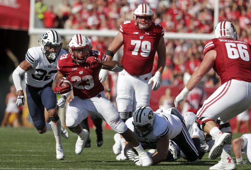 FILE - In this Sept. 15, 2018, file photo, Wisconsin's Jonathan Taylor runs during the first half of an NCAA college football game against BYU Saturday,, in Madison, Wis. The nation's leading rusher, Wisconsin's Jonathan Taylor, is headed back east when the Badgers face No. 21 Penn State on Saturday.  (AP Photo/Morry Gash, File)