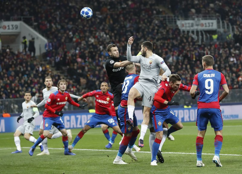 Roma defender Kostas Manolas heads the ball to score the opening goal during a Group G Champions League soccer match between CSKA Moscow and Roma at the Luzhniki Stadium in Moscow, Wednesday, Nov. 7, 2018. (AP Photo/Pavel Golovkin)