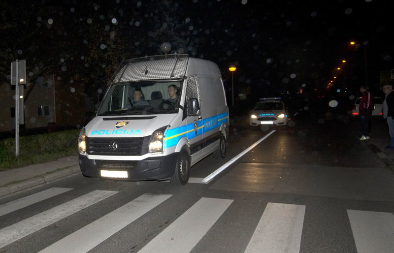 A police van thought to be carrying Croatian tycoon Ivica Todoric arrives to Zagreb central prison, in Zagreb, Croatia, Wednesday, Nov. 7, 2018.  British authorities have extradited the founder of an indebted food and retail company who was Croatia's most-wanted fugitive. (AP Photo/Darko Bandic)