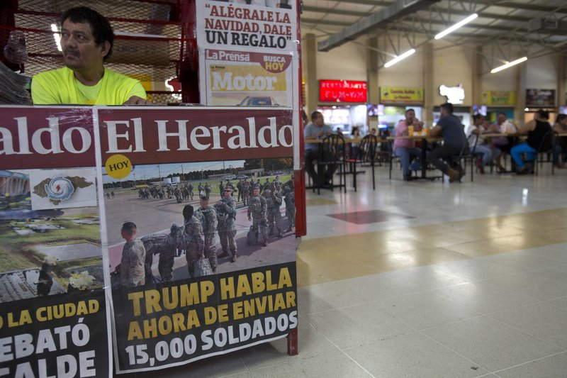 This Nov. 1, 2018 photo shows a newspaper kiosk advertising the day's headline that reads in Spanish: