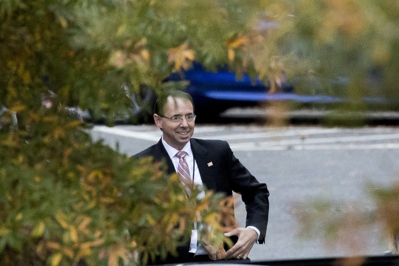 Deputy Attorney General Rod Rosenstein waits for his car as he departs the West Wing of the White House in Washington, Wednesday, Nov. 7, 2018. Attorney General Jeff Sessions was pushed out Wednesday as the country's chief law enforcement officer after enduring more than a year of blistering and personal attacks from President Donald Trump over his recusal from the Russia investigation. . (AP Photo/Andrew Harnik)