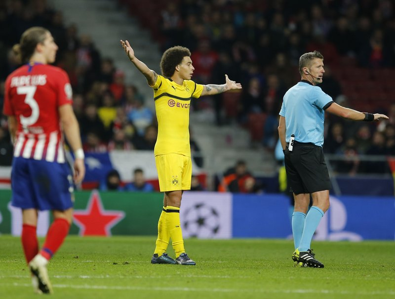 Borussia Dortmund's Axel Witsel reacts during the Group A Champions League soccer match between Atletico Madrid and Borussia Dortmund at Wanda Metropolitano stadium in Madrid, Spain, Tuesday, Nov. 6, 2018. (AP Photo/Paul White)
