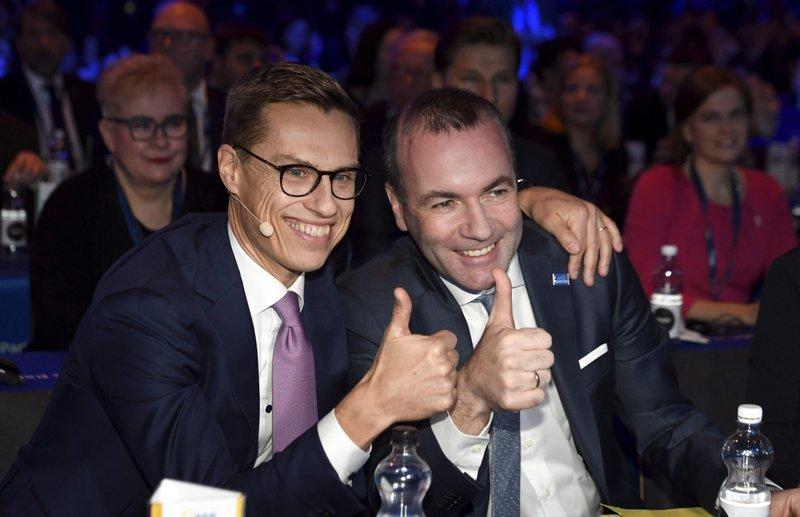 Candidates of the EPP, Alexander Stubb of Finland, left, and Manfred Weber of Germany pose together before the session of the European People's Party (EPP) congress in Helsinki, Finland, Thursday Nov. 8, 2018. The EPP, the group uniting Europe's center-right parties, has been wringing its hands over whether to keep Hungarian Prime Minister Viktor Orban and Fidesz in the fold or cut them loose before European Parliament elections in May. (Markku Ulander/Lehtikuva via AP)