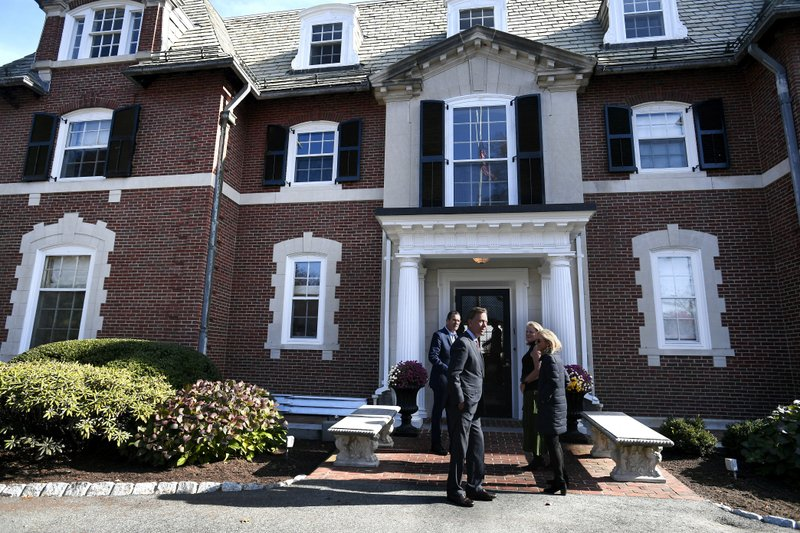 Governor Dannel P. Malloy and wife Cathy greet Connecticut's new governor-elect Ned Lamont, front center, and wife Annie at the Governor's residence for lunch in Hartford, Conn., Thursday, Nov. 8, 2018. (AP Photo/Jessica Hill)