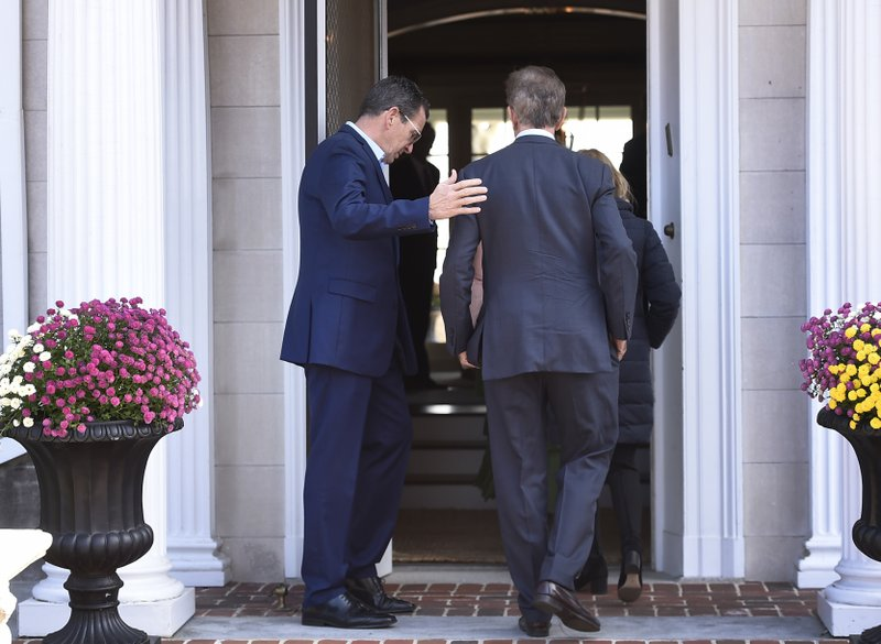 Governor Dannel P. Malloy, left, greets Connecticut's new governor-elect Ned Lamont at the Governor's residence for lunch in Hartford, Conn., Thursday, Nov. 8, 2018. (AP Photo/Jessica Hill)