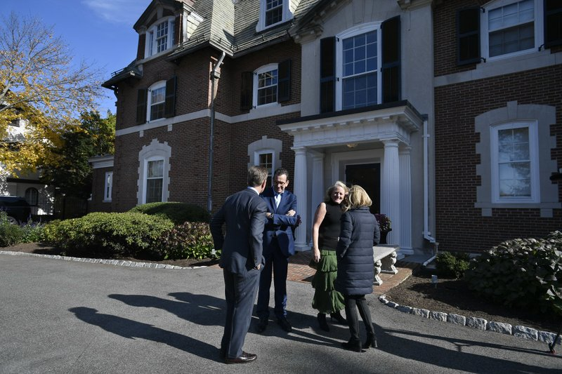 Governor Dannel P. Malloy, center left, and wife Cathy Malloy, center right, greet Connecticut's new governor-elect Ned Lamont, left, and wife Annie Lamont, right, at the Governor's residence for lunch in Hartford, Conn., Thursday, Nov. 8, 2018. (AP Photo/Jessica Hill)