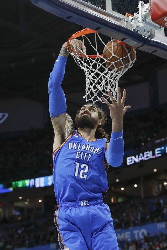 Oklahoma City Thunder center Steven Adams (12) goes up for a basket against the Houston Rockets during the first quarter of an NBA basketball game Thursday, Nov. 8, 2018, in Oklahoma City. (AP Photo/Alonzo Adams)