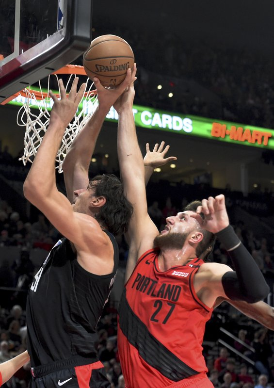 Portland Trail Blazers center Jusuf Nurkic, right, blocks the shot of Los Angeles Clippers center Boban Marjanovic, left, during the first half of an NBA basketball game in Portland, Ore., Thursday, Nov. 8, 2018. (AP Photo/Steve Dykes)