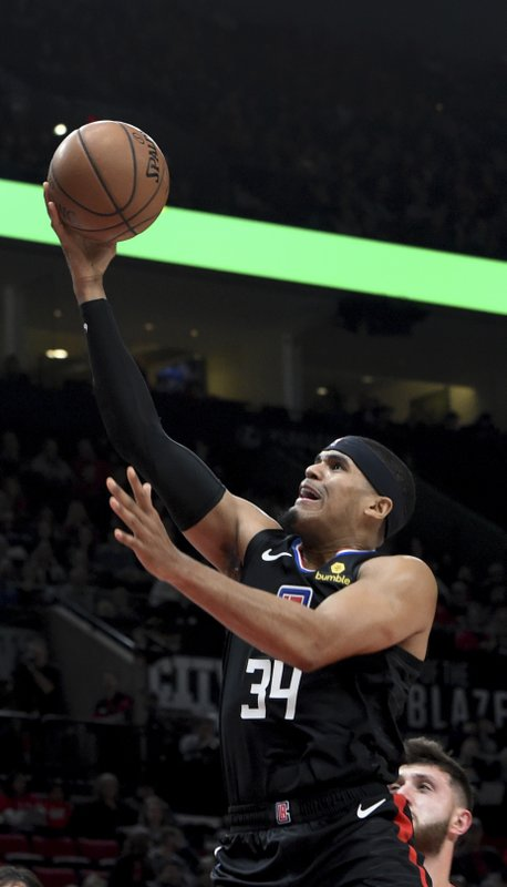 Los Angeles Clippers forward Tobias Harris, left, drives to the basket past Portland Trail Blazers center Jusuf Nurkic, right, during the first half of an NBA basketball game in Portland, Ore., Thursday, Nov. 8, 2018. (AP Photo/Steve Dykes)