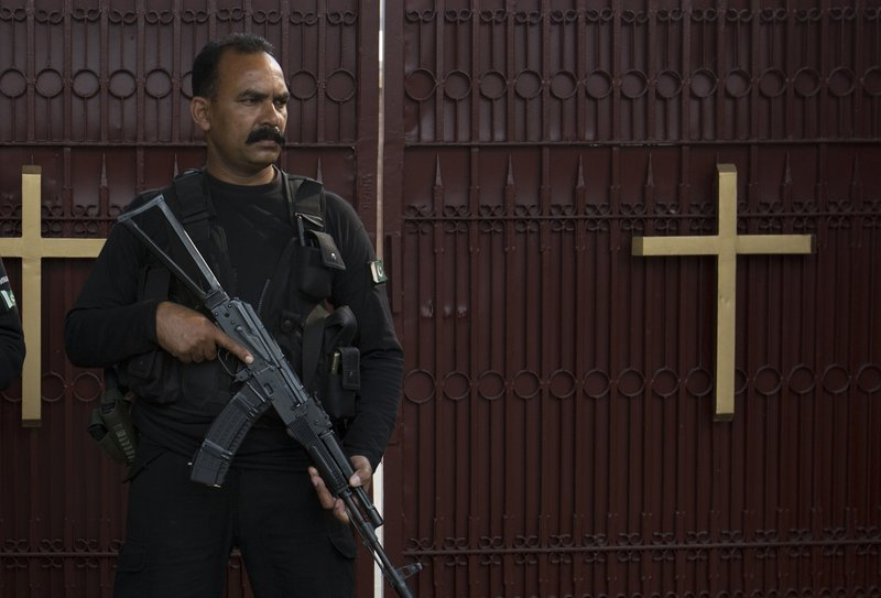 In this Oct. 31, 2018, photo, a Pakistani police commando stands guard outside St. Thomas' church in Islamabad, Pakistan, Oct. 31, 2018. The uproar surrounding Aasia Bibi _ a Pakistani Christian woman who was acquitted of blasphemy charges and released from death row but remains in isolation for her protection _ has drawn attention to the plight of the country's Christians.The minority, among Pakistan's poorest, has faced an increasingly intolerant atmosphere in this Muslim-majority nation where radical religious and sectarian groups have become more prominent in recent years. (AP Photo/B.K. Bangash)