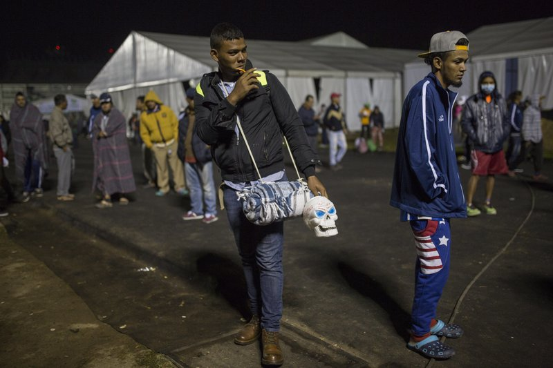 A Central American migrant prepares to leave the temporary shelter in the Jesus Martinez stadium, in Mexico City, Friday, Nov. 9, 2018. A group of 500 migrants decided to get ahead of the caravan and head north towards the city of Queretaro. (AP Photo/Rodrigo Abd)
