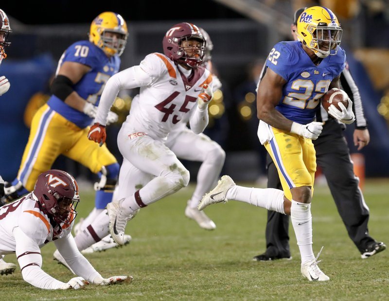 Pittsburgh running back Darrin Hall (22) breaks away from Virginia Tech defensive lineman TyJuan Garbutt (45) for a long touchdown run i the third quarter of an NCAA football game, Saturday, Nov. 10, 2018, in Pittsburgh. Pittsburgh won 52-22.(AP Photo/Keith Srakocic)