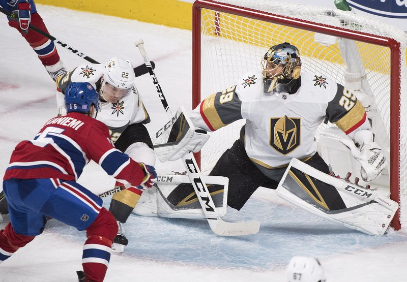 Vegas Golden Knights goaltender Marc-Andre Fleury is scored on by Montreal Canadiens' Jesperi Kotkaniemi, left, as Golden Knights' Nick Holden (22) defends during the second period of an NHL hockey game, Saturday, Nov. 10, 2018 in Montreal. (Graham Hughes/The Canadian Press via AP)