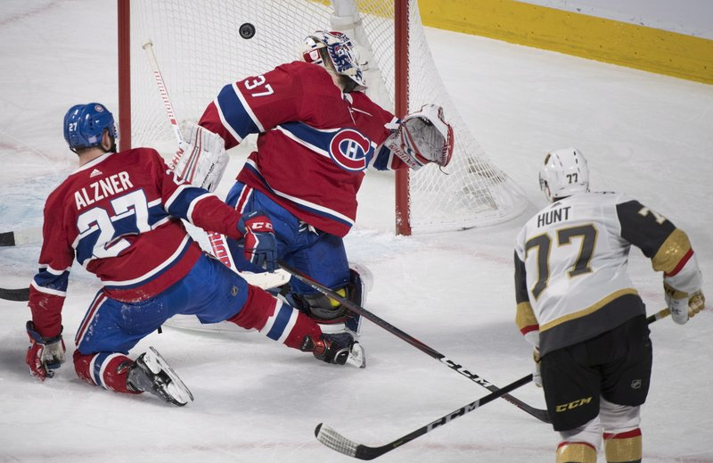 Vegas Golden Knights' Brad Hunt (77) scores against Montreal Canadiens goaltender Antti Niemi as Canadiens' Karl Alzner defends during the first period of an NHL hockey game, Saturday, Nov. 10, 2018 in Montreal. (Graham Hughes/The Canadian Press via AP)