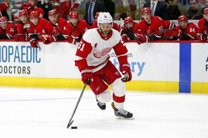 Detroit Red Wings' Frans Nielsen (51) brings the puck up the ice during the third round of the shootout as the Carolina Hurricanes watch from the bench during an NHL hockey game Saturday, Nov. 10, 2018, in Raleigh, N.C. (AP Photo/Karl B DeBlaker)