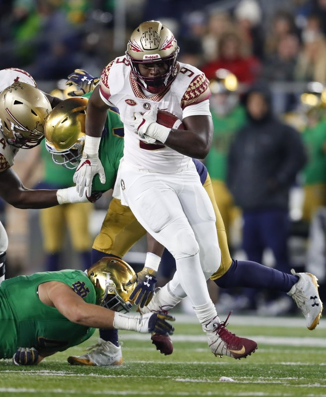 Florida State running back Jacques Patrick (9) runs against Notre Dame in the first half of an NCAA college football game in South Bend, Ind., Saturday, Nov. 10, 2018. (AP Photo/Paul Sancya)