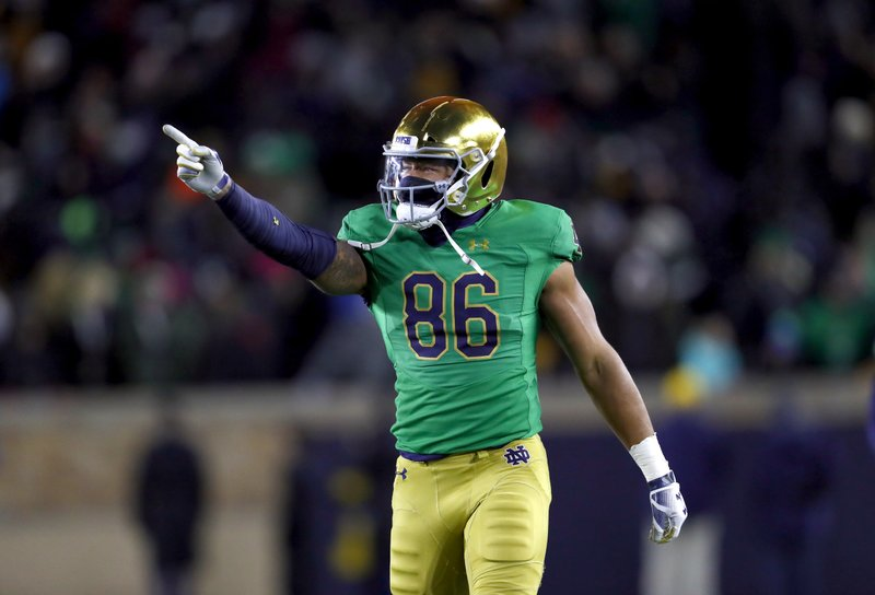 Notre Dame tight end Alize Mack (86) celebrates his touchdown catch against Florida State in the first half of an NCAA college football game in South Bend, Ind., Saturday, Nov. 10, 2018. (AP Photo/Paul Sancya)