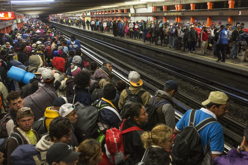Central American migrants wait for subway cars as they resume their journey north after leaving the temporary shelter at the Jesus Martinez stadium, in Mexico City, Saturday, Nov. 10, 2018. Thousands of Central American migrants were back on the move toward the U.S. border Saturday, after dedicated Mexico City metro trains whisked them to the outskirts of the capital and drivers began offering rides north. (AP Photo/Rodrigo Abd)