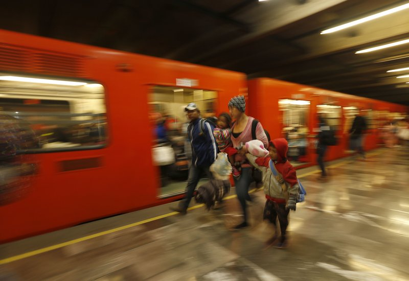 Central American migrants arrive at a subway station after leaving the temporary shelter at the Jesus Martinez stadium, in Mexico City, Saturday, Nov. 10, 2018. Thousands of Central American migrants were back on the move toward the U.S. border Saturday, after dedicated Mexico City metro trains whisked them to the outskirts of the capital and drivers began offering rides north. (AP Photo/Marco Ugarte)