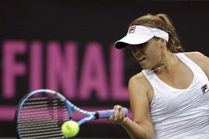 Sofia Kenin of the United States hits a forehand to Katerina Siniakova of the Czech Republic during their tennis match of the Fed Cup Final between Czech Republic and United States in Prague, Czech Republic, Sunday, Nov. 11, 2018. (AP Photo/Petr David Josek)