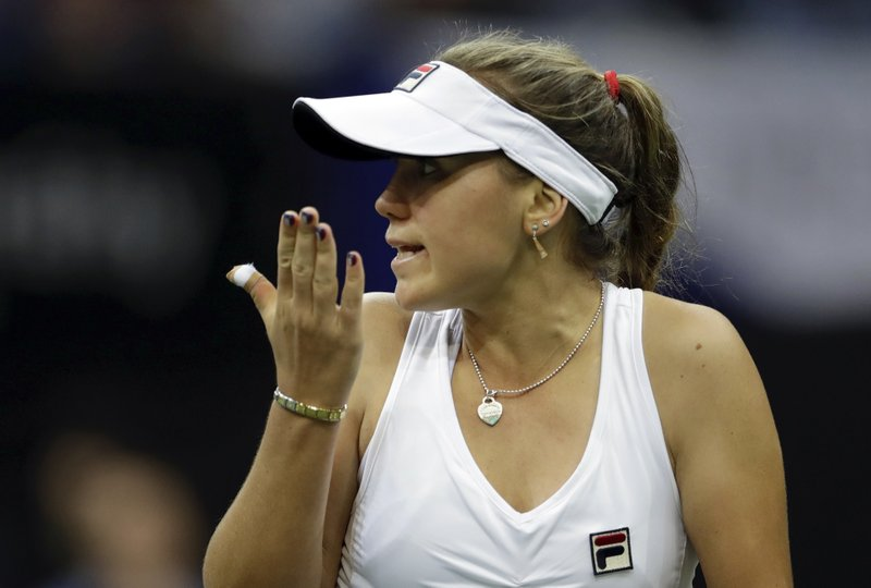 Sofia Kenin of the United States gestures while playing Katerina Siniakova of the Czech Republic in their tennis match of the Fed Cup Final between Czech Republic and United States in Prague, Czech Republic, Sunday, Nov. 11, 2018. (AP Photo/Petr David Josek)