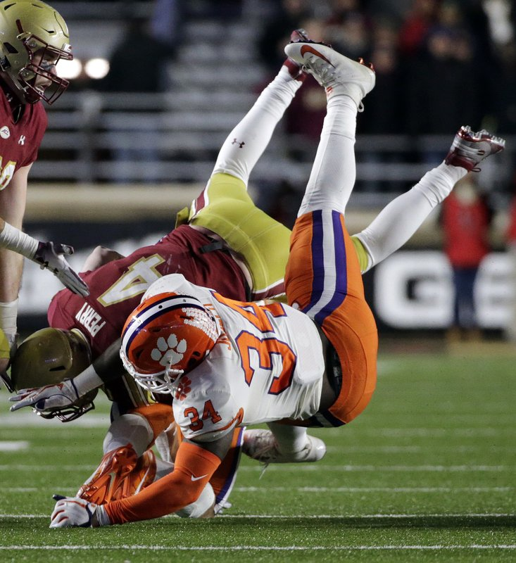 Clemson linebacker Kendall Joseph (34) drives Boston College quarterback EJ Perry to the turf during the second half of an NCAA college football game, Saturday, Nov. 10, 2018, in Boston. (AP Photo/Elise Amendola)