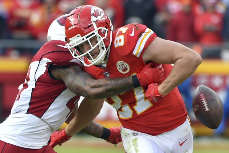 Kansas City Chiefs tight end Travis Kelce (87) fumbles the ball during a tackle by Arizona Cardinals safety Antoine Bethea (41) during the second half of an NFL football game in Kansas City, Mo., Sunday, Nov. 11, 2018. The ball rolled out of bounds. (AP Photo/Ed Zurga)