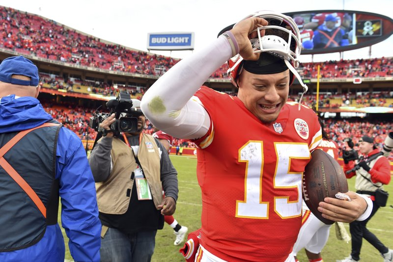 Kansas City Chiefs quarterback Patrick Mahomes (15) holds on to the game ball as he removes his helmet following an NFL football game against the Arizona Cardinals in Kansas City, Mo., Sunday, Nov. 11, 2018. (AP Photo/Ed Zurga)