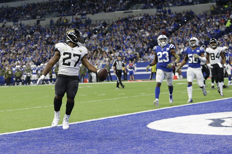 Jacksonville Jaguars running back Leonard Fournette (27) scores a touchdown against the Indianapolis Colts during the second half of an NFL football game in Indianapolis, Sunday, Nov. 11, 2018. (AP Photo/AJ Mast)