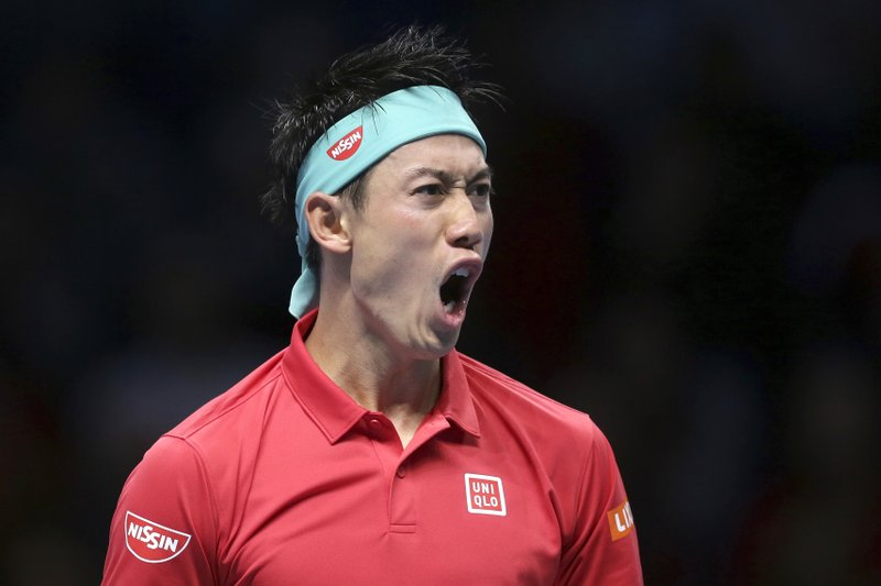 Japan's Kei Nishikori shouts after winning a point during his ATP World Tour Finals singles final tennis match against Switzerland's Roger Federer at the O2 Arena in London, Sunday Nov. 11, 2018. (AP Photo/Tim Ireland)